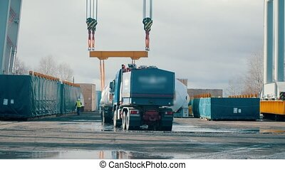 Cargo shipping - a big truck arriving on the construction site - workers about to accept the cargo