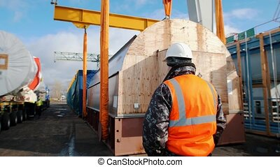 Cargo shipping - a man worker standing on the construction site