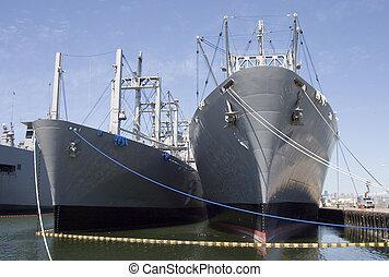 Cargo ships at dock.
