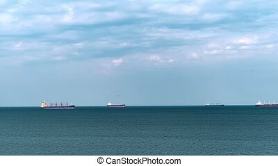 Cargo ships at sea. time lapse