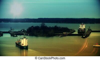 Cargo ships at sunset passing Kiel