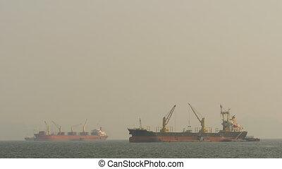 Cargo ships float in the sea. Asia. Vietnam. - Cargo ships...