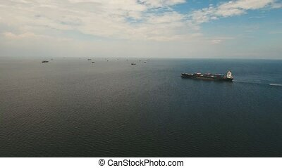 Cargo ships in the bay Manila - aerial footage freight and...