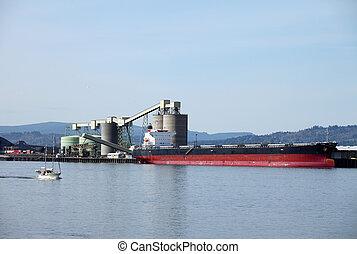 Cargo ships maritime transportation - A cargo ship loading...