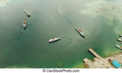 Cargo ships moored in the bay. - Freight ships and ferries...