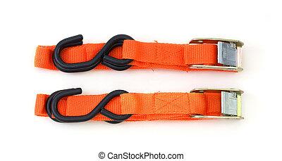 Cargo straps - Two bright orange colored cargo straps with...