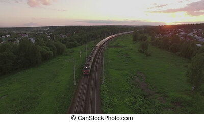 Cargo train crossing countryside at sunset, Russia - Aerial...