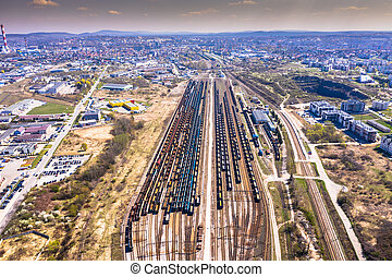 Cargo trains. Aerial view of colorful freight trains on the railway station. Wagons with goods on railroad. Aerial view