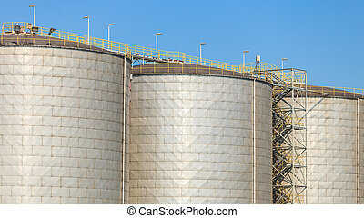 Silo in morning harbour. - Cargo transport commerce concept....