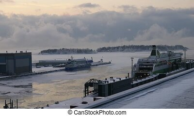 Cargo trucks leaves ferry ship during winter early morning