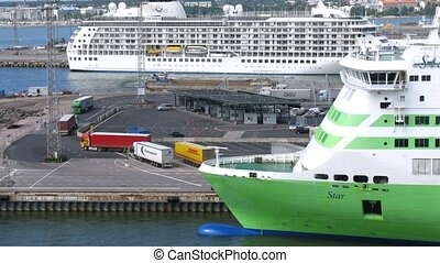 Cargo trucks pass by big ferry ship bow
