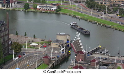 cargoship passes through a lock on one of channels in Rotterdam