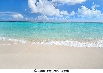 Caribbean aqua waters, beach and blue sky of the British Virgin Islands