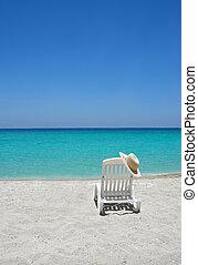 Caribbean beach chair - Empty tropical beach chair with hat...