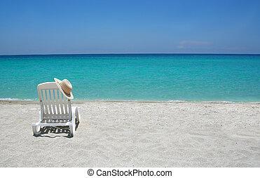 Caribbean beach chairs - Empty tropical beach chair with hat...