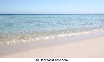 View of clean Caribbean beach with white sand. Calm ocean. Dominican Republic.