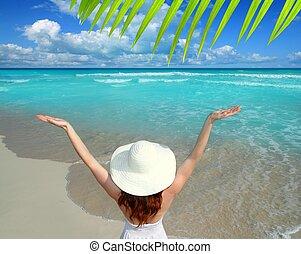 Caribbean beach woman rear view hat open arms