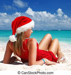 Caribbean Christmas - Woman on the beach in santa's hat