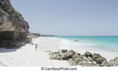 Caribbean cruise travel woman walking on Beachy Head beach ...