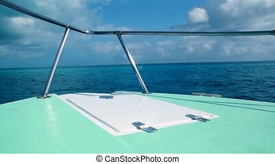 Caribbean green boat bow turquoise sea blue sky vacation day...