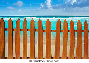 Caribbean island fence in turquoise beach