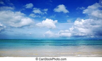 Caribbean sea and blue clouds sky.