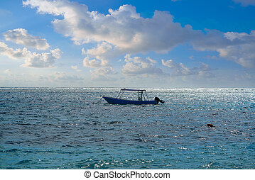 Caribbean sea beach with boat in Mexico