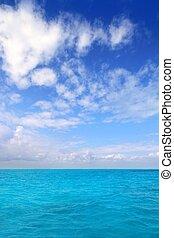 Caribbean sea horizon blue sky clouds Mexico
