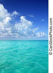 Caribbean sea horizon on blue sky vacation day