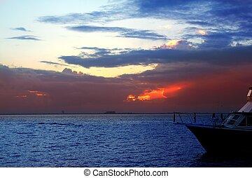 Caribbean sea sunset in Mexico Isla Mujeres boat