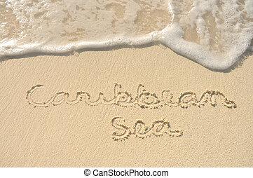 Caribbean Sea Written in Sand on Beach