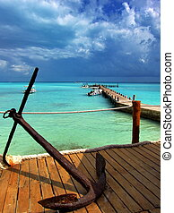 Caribbean Seascape with blue sky, turquoise water and old...