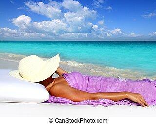 Caribbean tourist resting beach hat woman hammock bed