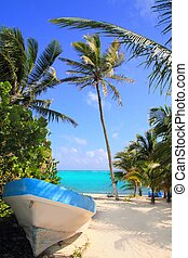 Caribbean tropical beach with boat beached Mayan Riviera