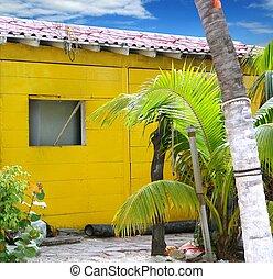 Caribbean tropical yellow beach wooden house