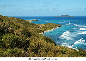 A view of the Caribbean sea and the coastal road leading to the further most east point in the United States, Point Udall on the US Virgin Island of St. Croix.
