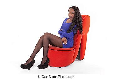 Caribbean woman sitting in studio
