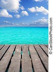 Caribbean wood pier with turquoise aqua sea blue sky Mayan...
