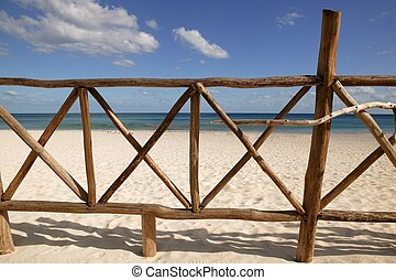 Caribbean wooden tropical fence wall on the beach