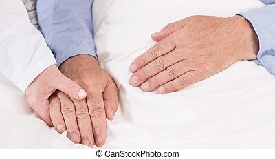 Caring about ill man - Close-up of nurse caring about ill...