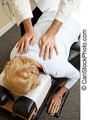 Caring Chiropractic Treatment - Closeup of a chiropractor\'s...