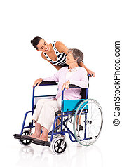 daughter talking to disabled senior mother