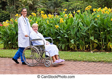 caring doctor and senior patient