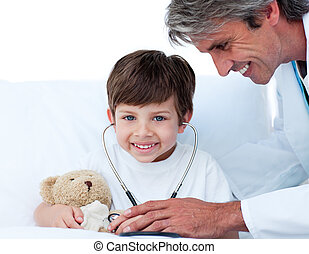 Caring doctor playing with a little boy