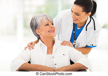 caring doctor with senior patient in office
