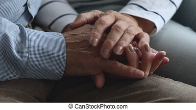 Caring elderly wife holding hand of senior grandpa give ...