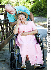 Caring for Disabled Wife - Senior man caring for his...