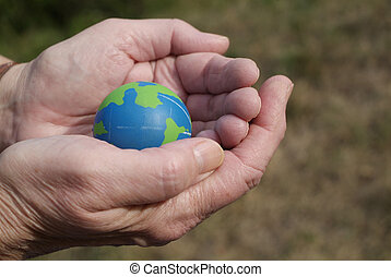 caring for the environment - blue and green globe in the...