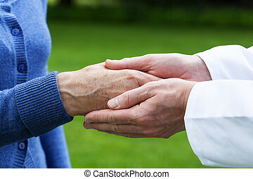 Caring hands - Doctor's hands showing care towards his...