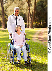 medical doctor and senior patient outdoors